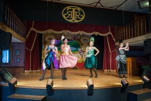Four can-can girls performing on stage in the Palace at Tweetsie Railroad.