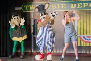 Porter, Hopper and Jenny performing on stage in the Miner's Mountain Theater at Tweetsie Railroad.