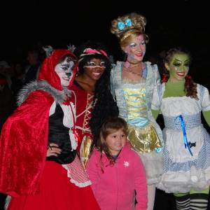 The Spice Ghouls, professional actors and dancers posing for a picture with a guest during Ghost Train Halloween Festival at Tweetsie Railroad, Blowing Rock, North Carolina